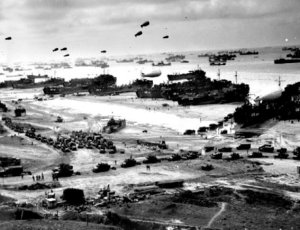 D-Day1: The barrage balloons depicted in this D-Day invasion photo were a vital part of protecting Allied forces from strafing German aircraft. The balloons were manned by Soldiers of the all-black 320th Very Low Altitude (VLA) barrage balloon battalion. Steel... (from here)