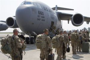 Oregon Army National Guard, 41st Infantry Brigade Combat Team Soldiers from load onto a C-17 Globemaster III Aug. 13, 2013, bound for Afghanistan from Mihail Kogalniceanu Air Base, Romania. The flight is one of more than 500, deploying and redeploying transportation missions, that the U.S. Army Europe's 21st Theater Sustainment Command and Air Force's 780th Expeditionary Airlift Squadron have supported since opening the transit hub in February 2014. (U.S. Army photo/Sgt. Brandon Hubbard -- from here)