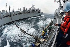 130320-N-TG831-099 WATERS TO THE WEST OF THE KOREAN PENINSULA (March 20, 2013) The Military Sealift Command fast combat support ship USNS Rainier (T-AOE-7), left, performs a replenishment-at-sea with the Arleigh Burke-class guided-missile destroyer USS McCampbell (DDG 85). McCampbell is part of Destroyer Squadron (DESRON) 15, forward deployed to Yokosuka, Japan, and is underway to conduct exercise Foal Eagle 2013 with allied nation Republic of Korea in support of regional security and stability of the Indo-Asia-Pacific region. (U.S. Navy photo by Mass Communication Specialist 3rd Class Declan Barnes/Released)