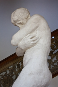Eve covers herself and lowers her head in shame in Rodin's Eve after the Fall. (from here)