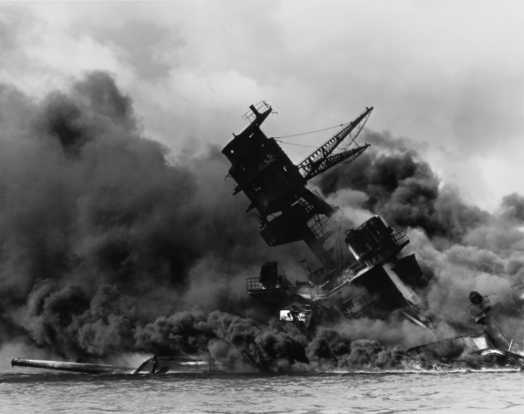 The USSArizona(BB-39) sunk and burning during the attack on Pearl Harbor, December 7, 1941 (from here)